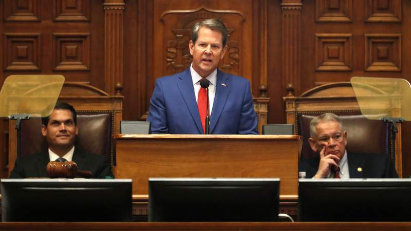 Gov. Brian Kemp is flanked by House Speaker David Ralston, R-Blue Ridge, right, and Lt. Gov. Geoff Duncan as he speaks during the State of the State address before a joint session of the Georgia General Assembly Thursday in Atlanta.