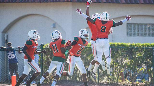 Mandarin players celebrate a touchdown against Atlantic Coast during the Publix Bold City Showcase.