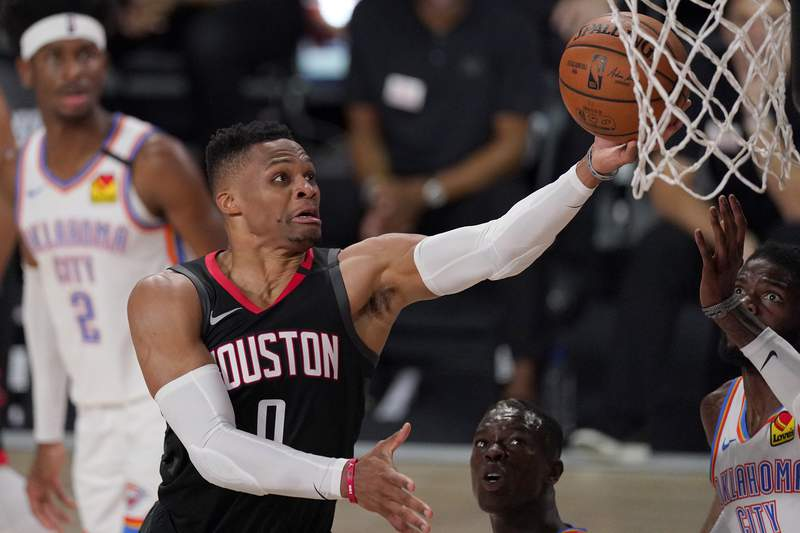 FILE - In this Wednesday, Sept. 2, 2020 file photo, Houston Rockets' Russell Westbrook (0) goes up for a shot as Oklahoma City Thunder's Nerlens Noel, right, defends during the second half of an NBA first-round playoff basketball game in Lake Buena Vista, Fla. The Houston Rockets have traded Russell Westbrook to the Washington Wizards for John Wall and a future lottery-protected. first-round pick.   Both teams announced the trade Wednesday night, Dec. 2, 2020. (AP Photo/Mark J. Terrill, File)