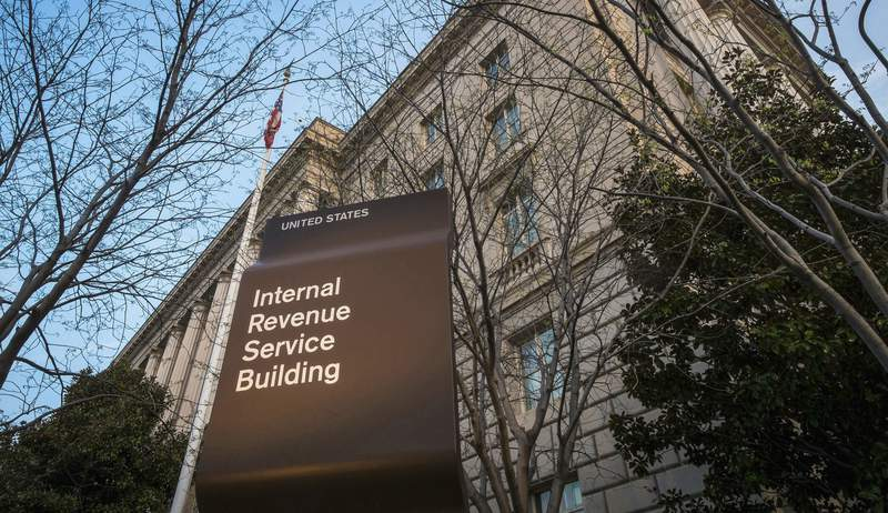 FILE - This April 13, 2014, file photo shows the Internal Revenue Service (IRS) headquarters building in Washington. The Treasury Department and the IRS are urging taxpayers who want to get their economic impact payments directly deposited to their bank accounts to enter their information online by Wednesday, May 11, 2020. The IRS said that people should use the Get My Payment tool on the IRS website by noon on Wednesday to provide their direct deposit information. (AP Photo/J. David Ake, File)