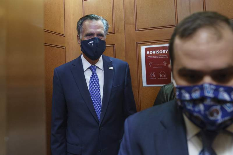 Sen. Mitt Romney, R-Utah, leaves the Senate Chamber after a procedural vote, at the Capitol in Washington, Monday, Sept. 21, 2020. Romney is one of four Republicans who could oppose a vote on a replacement for the late Justice Ruth Bader Ginsburg prior to Election Day. (AP Photo/J. Scott Applewhite)