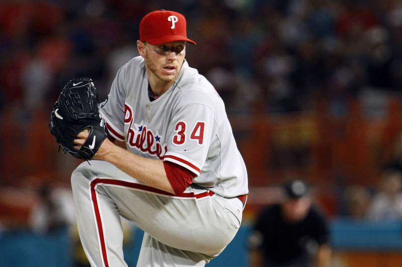 FILE - In this May 29, 2010, file photo, Philadelphia Phillies starting pitcher Roy Halladay throws a pitch in the ninth inning of a baseball game against the Florida Marlins in Miami. The Phillies will retire the late Hall of Fame pitcher's No. 34 this season. The Phillies will pay tribute to Halladay on May 29, 2020, the 10th anniversary of his perfect game against the Marlins. Halladay was 40 when he was killed in a plane crash in November 2017.  (AP Photo/Wilfredo Lee, File)