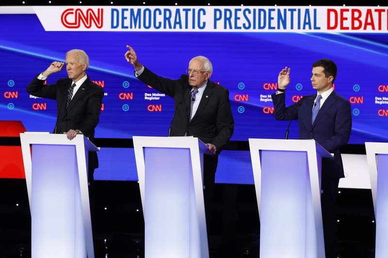 FILE - In this Tuesday, Jan. 14, 2020 file photo, from left, Democratic presidential candidate former Vice President Joe Biden, Sen. Bernie Sanders, I-Vt.,and former South Bend Mayor Pete Buttigieg look to answer a question during a Democratic presidential primary debate hosted by CNN and the Des Moines Register in Des Moines, Iowa. Multiple Democratic presidential hopefuls have talked about their faith on the campaign trail, weaving it into their approach to issues from immigration to climate change. Among the most vocal Democrats on that front is Buttigieg, who asserted his partys connection to religion on Tuesday during its final primary debate before next months first-in-the-nation Iowa caucus. (AP Photo/Patrick Semansky, File)
