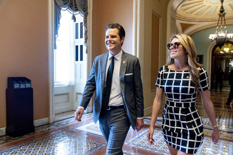 Rep. Matt Gaetz, R-Fla., and his wife Ginger Luckey walk through the U.S. Capitol Building in Washington, Tuesday, Sept. 28, 2021. (AP Photo/Andrew Harnik)