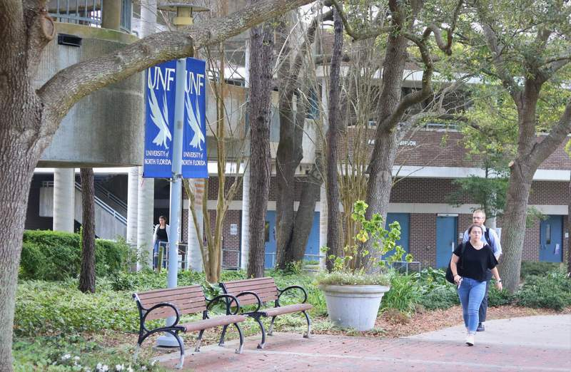 Students walk across the University of North Florida campus.