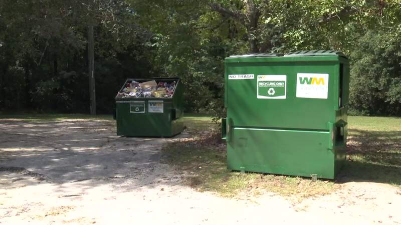 Trash surrounding the dumpsters at the recycling drop-off site at Earl Johnson Memorial Park on St. Augustine Road was picked up, but the dumpsters were still full on Tuesday.