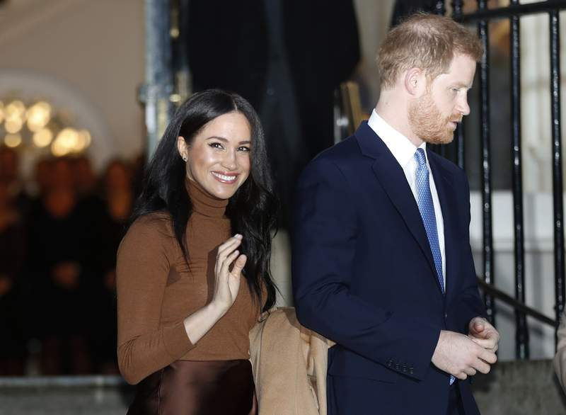 FILE - In this Jan. 7, 2020, file photo, Britain's Prince Harry and Meghan, Duchess of Sussex leave after visiting Canada House in London, after their recent stay in Canada. Prince Harry and Meghan Markle are to no longer use their HRH titles and will repay 2.4 million of taxpayer's money spent on renovating their Berkshire home, Buckingham Palace announced Saturday, Jan. 18. 2020. (AP Photo/Frank Augstein, File)