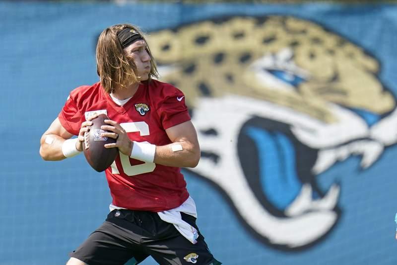 Jacksonville Jaguars quarterback Trevor Lawrence runs a drill during an NFL football practice, Tuesday, June 15, 2021, in Jacksonville, Fla. (AP Photo/John Raoux)