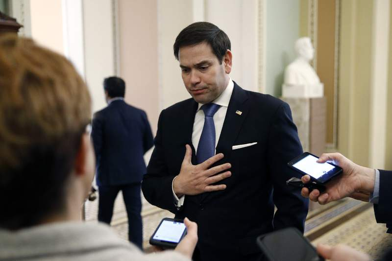 Sen. Marco Rubio, R-Fla., speaks with reporters on Capitol Hill in Washington, Tuesday, March 24, 2020, as the Senate works to pass a coronavirus relief bill. (AP Photo/Patrick Semansky)