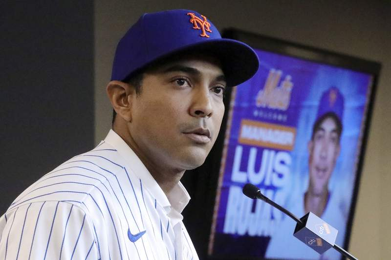 FILE - In this Jan. 24, 2020, file photo, New York Mets new manager Luis Rojas speaks during a baseball news conference after his introduction in New York. Mets manager Luis Rojas condemned the behavior of former New York hitting performance coordinator Ryan Ellis on Wednesday, Feb. 17, 2021 but said he never witnessed his longtime coworker act inappropriately after Ellis was fired recently for sexually harassment. (AP Photo/Bebeto Matthews, File)