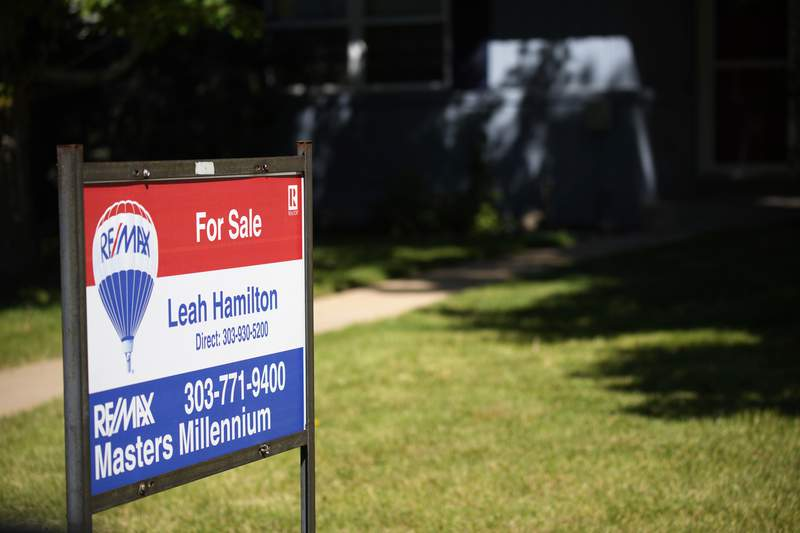 A sale sign stands outside a home on the market Tuesday, Sept. 21, 2021, in southeast Denver. The National Association of Realtors releases existing home sales for August on Wednesday, Sept. 22. (AP Photo/David Zalubowski)