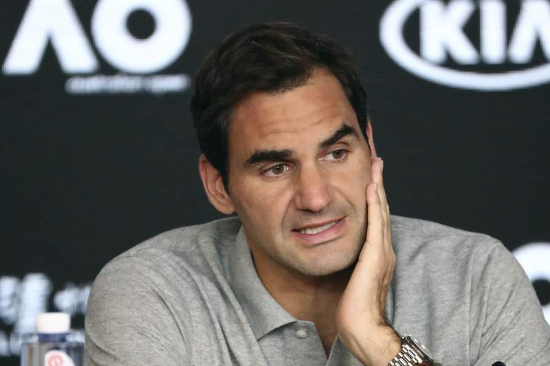 FILE - In this Jan. 30, 2020, file photo, Switzerland's Roger Federer speaks during a press conference following his semifinal loss to Serbia's Novak Djokovic at the Australian Open tennis championship in Melbourne, Australia. Federer has raised the prospect of merging the governing bodies that oversee the mens and womens professional tennis tours. The 20-time Grand Slam champion began a string of posts on Twitter by saying the shutdown of tennis because of the coronavirus outbreak has given the sport an ideal opportunity to assess its future. Federer says it might be the time for mens and womens tennis to be united and come together as one. (AP Photo/Dita Alangkara, File)