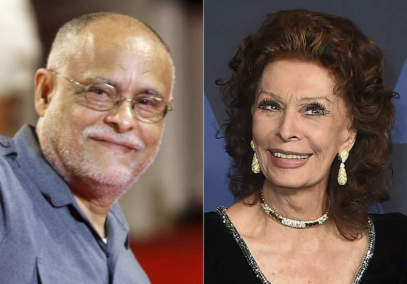 Director Haile Gerima appears at the 65th edition of the Venice Film Festival in Venice, Italy, on Sept. 2, 2008, left, and Sophia Loren arrives at the Governors Awards in Los Angeles on Oct. 27, 2019. Loren and independent filmmaker Haile Gerima will be honored with special awards by the Academy Museum of Motion Pictures. (Photos by Andrew Medichini/AP, left, and Jordan Strauss/Invision/AP)