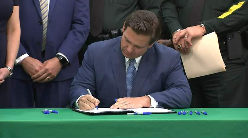 """Gov. DeSantis signs the so-called """"anti-riot"""" bill into law."""