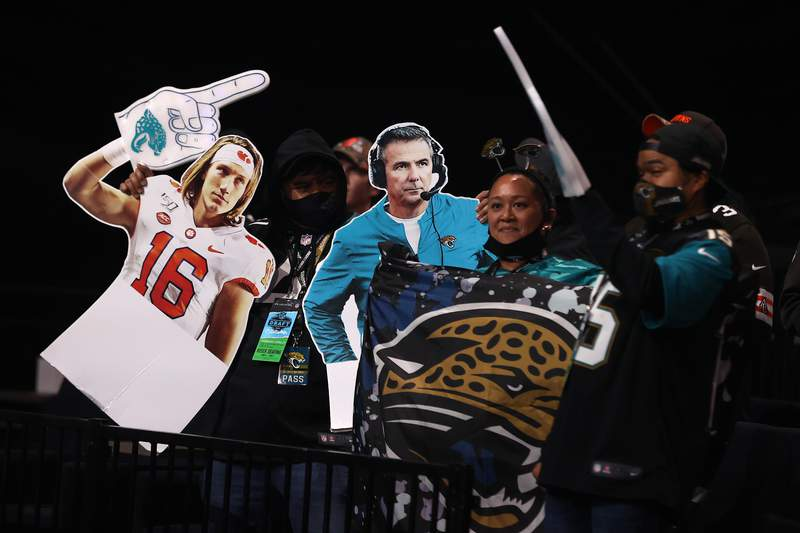 Fans react to NFL Commissioner Roger Goodell announcing Travis Etienne as the 25th selection by the Jacksonville Jaguars during round one of the 2021 NFL Draft at the Great Lakes Science Center on April 29, 2021 in Cleveland, Ohio. (Photo by Gregory Shamus/Getty Images)
