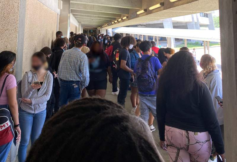 Students line up to enter the cafeteria at Frank H. Peterson Academies of Technology.