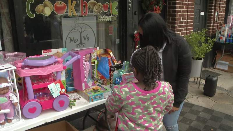 The toy giveaway began at noon Sunday at the Cookbook Restaurant.