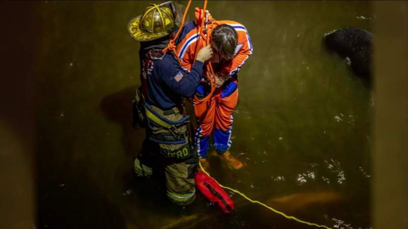 Jacksonville Fire-Rescue photo of driver being hoisted out of the St. Johns River after his car went off the Dames Point Bridge.