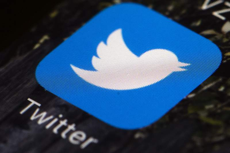 FILE - This April 26, 2017, file photo shows the Twitter app icon on a mobile phone in Philadelphia. On Monday, May 17, 2021, Russian authorities said they decided not to block Twitter after the social media platform deleted most of the banned content identified by Moscow and expressed readiness and interest in building a constructive dialogue. (AP Photo/Matt Rourke, File)