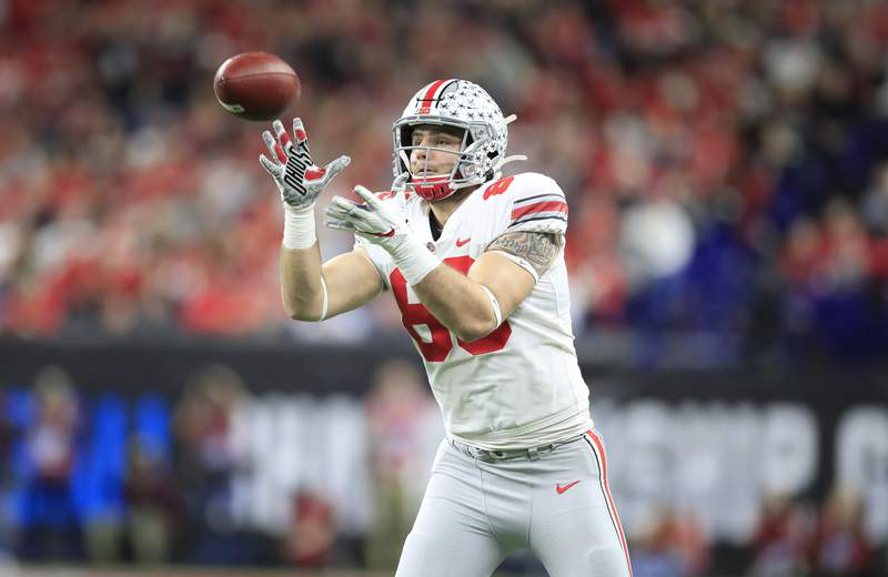 Luke Farrell of the Ohio State Buckeyes catches a pass off of a fake punt in the BIG Ten Football Championship Game against the Wisconsin Badgers at Lucas Oil Stadium on December 07, 2019 in Indianapolis, Indiana. (Photo by Andy Lyons/Getty Images)