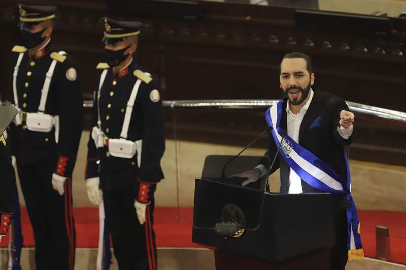 El Salvador's President Nayib Bukele delivers his annual address to the nation before Congress, in San Salvador, El Salvador, Tuesday, June 1, 2021. (AP Photo/Salvador Melendez)