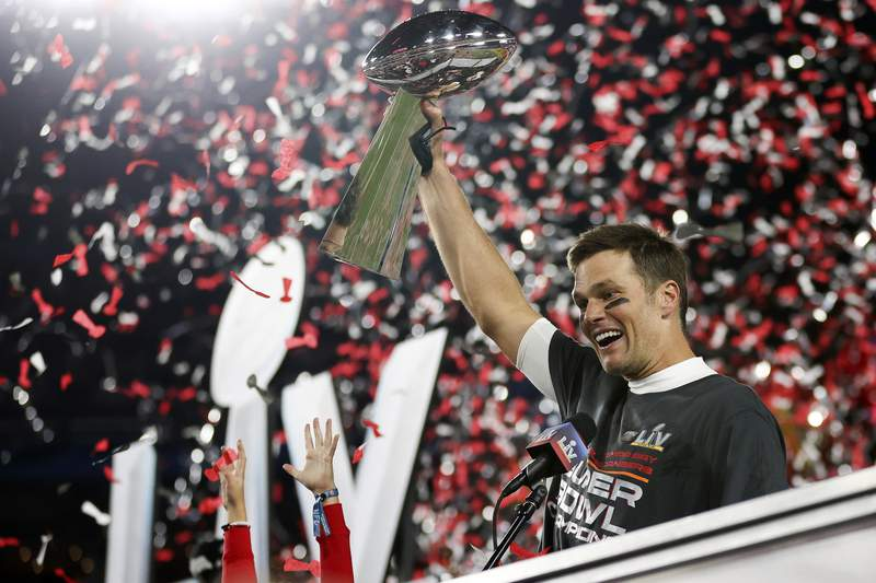 Tampa Bay Buccaneers quarterback Tom Brady (12) holds the Vince Lombardi trophy following the NFL Super Bowl 55 football game against the Kansas City Chiefs in Tampa.