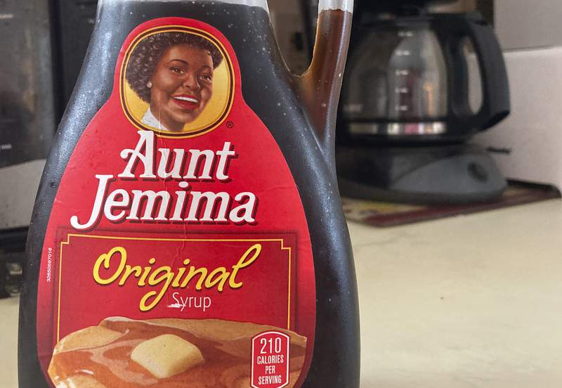 A bottle of Aunt Jemima syrup sits on a counter, Wednesday, June 17, 2020 in White Plains, N.Y.  Pepsico is changing the name and marketing image of its Aunt Jemima pancake mix and syrup, according to media reports. A spokeswoman for Pepsico-owned Quaker Oats Company told AdWeek that it recognized Aunt Jemimas origins are based on a racial stereotype and that the 131-year-old name and image would be replaced on products and advertising by the fourth quarter of 2020.  (AP Photo/Donald King)