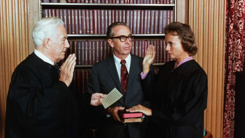 Sandra Day O'Connor is sworn in a Supreme Court Justice by Chief Justice Warren Burger. At center, holding two family Bibles, is her husband, John O'Connor (Photo by © CORBIS/Corbis via Getty Images)