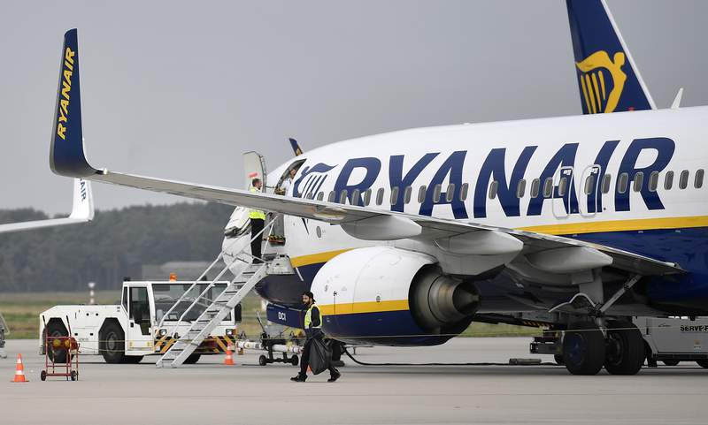 FILE - In this Sept. 12, 2018 file photo, a Ryanair plane is parked at the airport in Weeze, Germany.  Ryanair said Wednesday April 7, 2021, earnings for the current fiscal year are likely to be close to breakeven as continued travel restrictions delay its recovery from the COVID-19 pandemic. (AP Photo/Martin Meissner, File)