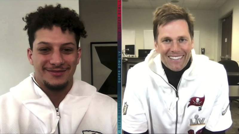 In this still image from video provided by the NFL, Kansas City Chiefs quarterback Patrick Mahomes, left, and Tampa Bay Buccaneers quarterback Tom Brady speak during Opening Night for the NFL Super Bowl 55 football game Monday, Feb. 1, 2021. (NFL via AP)