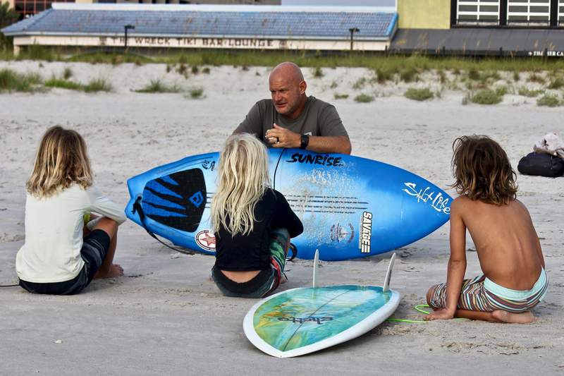 Jason Motes was named as the national surfing coach of the year by the National Scholastic Surfing Association. He's the first East Coast coach to win the award.