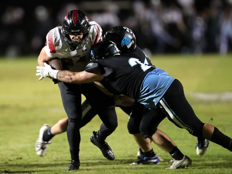 Creekside running back Preston Strope barrels through Ponte Vedra defenders during a Week 10 game. The Knights travel to face Gainesville Buchholz in the playoff opener on Friday. (Ralph D. Priddy)