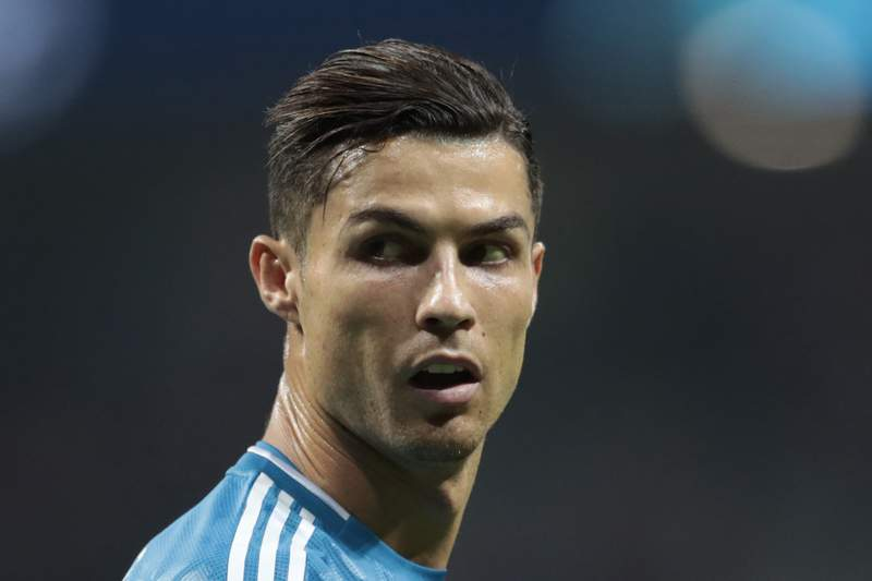 FILE - In this Sept. 18, 2019, file photo, Juventus' Cristiano Ronaldo looks back during the Champions League Group D soccer match in Madrid, Spain. A U.S. appeals court is letting a federal judge in Nevada decide claims by a woman suing soccer star Ronaldo over a $375,000 rape case hush-money settlement reached more than a decade ago. An attorney for Ronaldo declined to comment and a lawyer for Kathryn Mayorga did not respond Monday, Feb. 8, 2021, to messages about a Jan. 13, 2021, order by the 9th U.S. Circuit Court of Appeals. (AP Photo/Bernat Armangue, File)