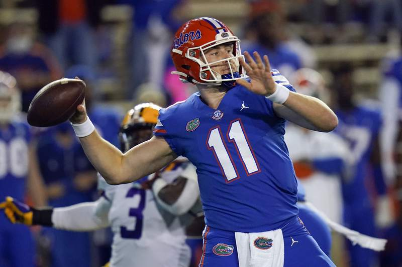 In this Dec. 12, 2020, photo, Florida quarterback Kyle Trask throws a pass against LSU during the first half of an NCAA college football game in Gainesville.