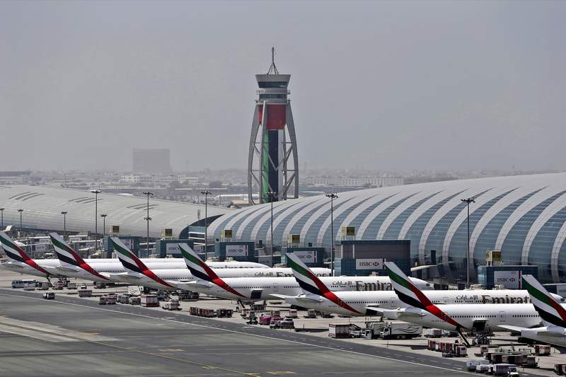 FILE - In this April 20, 2017, file photo, Emirates planes are parked at the Dubai International Airport in Dubai, United Arab Emirates. The Middle East's largest airline, Emirates, announced on Tuesday a net loss of $5.5 billion over the past year as revenue fell by more than 66% due to global travel restrictions sparked by the coronavirus pandemic. (AP Photo/Kamran Jebreili, File)