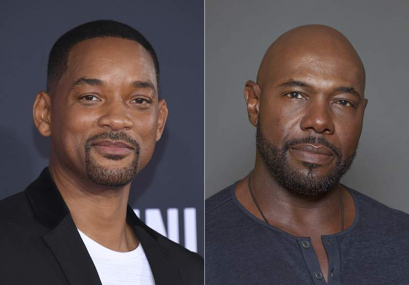 """Will Smith attends the premiere of """"Gemini Man"""" in Los Angeles on Oct. 6, 2019, left, and director Antoine Fuqua appears during a photo session in Los Angeles on July 12, 2015. Smith and director Fuqua have pulled production of their runaway slave drama Emancipation from Georgia over the states recently enacted law restricting voting access. The film is largest and most high profile Hollywood production to depart the state since Georgias Republican-controlled state Legislature passed a law that introduced stiffer voter identification requirements for absentee balloting. (AP Photo)"""