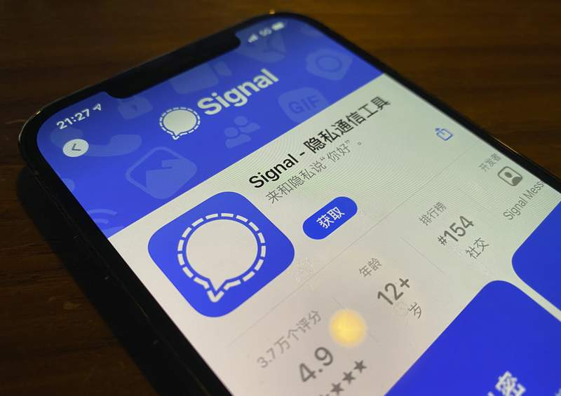 A smartphone screen shows the App Store page for Signal in Beijing on Tuesday, March 16, 2021. Encrypted messaging app Signal appears to have been blocked in mainland China, the latest foreign social media service to cease working in a country where the government tightly controls the flow of information. (AP Photo/Ng Han Guan)