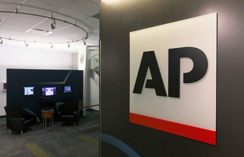 FILE - This Tuesday, April 26, 2016 file photo shows The Associated Press logo in New York. The Associated Press has pulled out of its planned coverage of Wednesday's CMA Awards show due to a dispute over photographs of the broadcast.  (AP Photo/Hiro Komae, File)