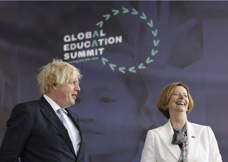 Britain's Prime Minister Boris Johnson alongside erstwhile  PM of Australia Julia Gillard during a acme  to rise  funds for the Global Partnership for Education (GPE), successful  London Thursday July 29, 2021.  The UK past  period  pledged 430 cardinal  pounds (dollars 700 cardinal  US) to the project, which aims to unafraid  astatine  slightest  5  cardinal  US dollars implicit    the adjacent  5  years. (Tolga Akmen/PA via AP)