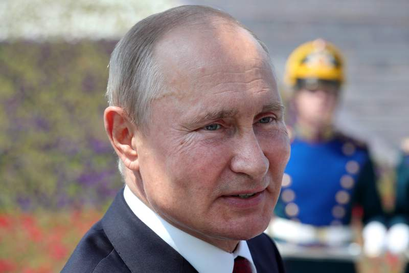 Russian President Vladimir Putin attends a ceremony of handing Gold Stars medals to heroes of labor marking the Day of Russia holiday in Moscow, Russia, on Friday, June 12, 2020. The ceremony marked the first big public event Putin attended since announcing a nationwide lockdown more than two months ago. (Mikhail Klimentyev, Sputnik, Kremlin Pool Photo via AP)