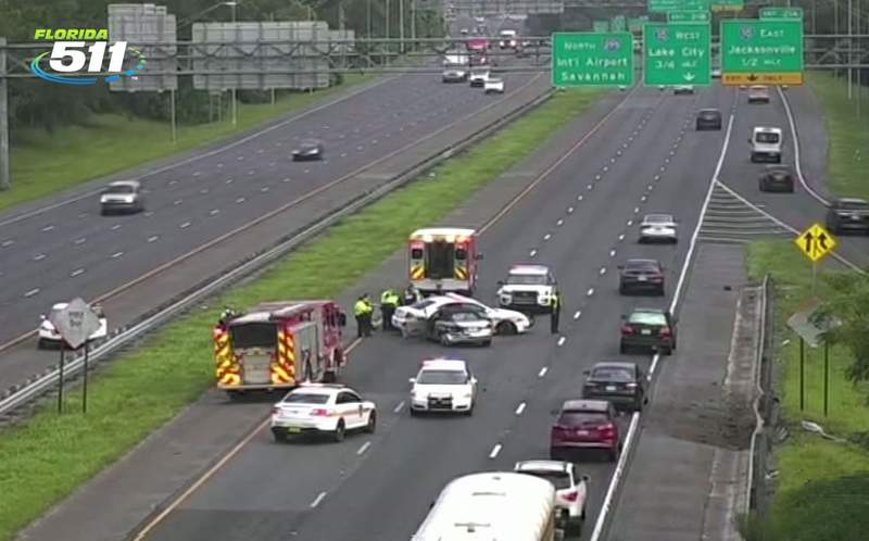 Passenger in police vehicle injured when a car lost control and struck the cruiser Tuesday morning on I-295.