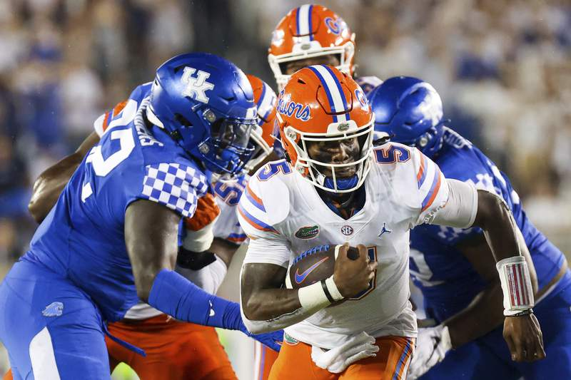 FILE - Florida quarterback Emory Jones (5) runs the ball upfield during the second half of an NCAA college football game against Kentucky in Lexington, Ky., Saturday, Oct. 2, 2021. (AP Photo/Michael Clubb)