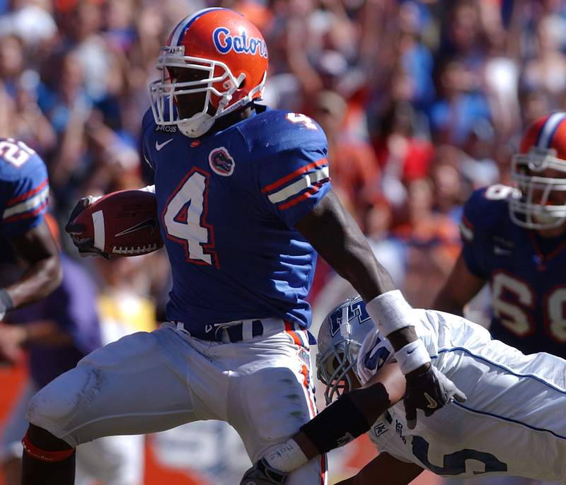 Florida's Ciatrick Fason (4) breaks away from Middle Tennessee's Damon Nickson (5) to score a touchdown in the second half in Gainesville, Fla., Saturday, Oct. 16, 2004. Florida defeated Middle Tennessee 52-16. (AP Photo/Phil Sandlin