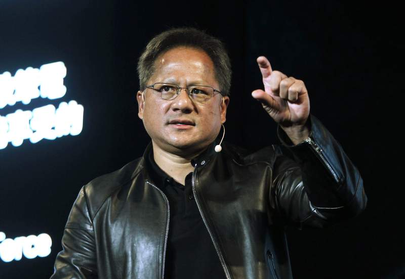 FILE - In this Tuesday, May 30, 2017 file photo, Nvidia CEO Jensen Huang delivers a speech about AI and gaming during the Computex Taipei exhibition at the world trade center in Taipei, Taiwan. Graphics chip maker Nvidia said Monday, Oct. 5, 2020 it plans to build Britain's fastest supercomputer that healthcare researchers can use to work on medical problems including COVID-19. Santa Clara, California-based Nvidia said it will spend 40 million pounds ($52 million) on the supercomputer, dubbed Cambridge-1, which will consist of 80 Nvidia systems and is expected to be online by the end of the year. (AP Photo/Chiang Ying-ying, File)