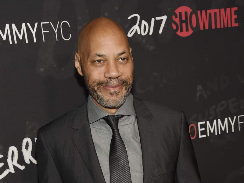"""FILE - In this April 13, 2017, file photo, John Ridley, executive producer of """"Guerrilla,"""" poses at a """"For Your Consideration"""" event for the Showtime series at the Writers Guild of America in Beverly Hills, Calif. Ridley will write the new Batman comic series with plans of the Dark Knight being a person of color. The Oscar-winning screenwriter and DC publisher Jim Lee announced plans for Ridley to write the miniseries during the DC FanDome virtual panel on Saturday, Aug. 22, 2020. (Photo by Chris Pizzello/Invision/AP, File)"""