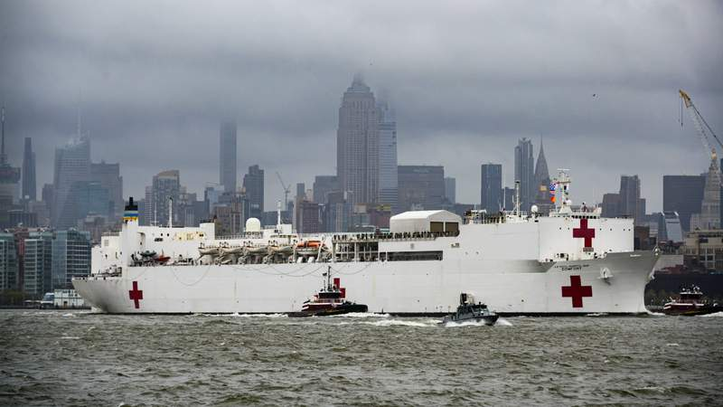 The USNS Comfort hospital ship sails in the Hudson River as it departs New York City after ending its coronavirus (COVID-19) duty on April 30, 2020. (Photo by Noam Galai