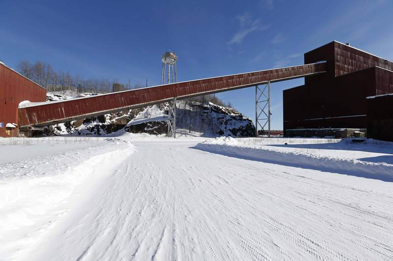 FILE - In this Feb. 10, 2016, file photo is a former iron ore processing plant near Hoyt Lakes, Minn., that would become part of a proposed PolyMet copper-nickel mine. An internal investigation has found that the Environmental Protection Agency mishandled its oversight of permits for what would be Minnesota's first copper-nickel mine, according to the federal agency's inspector general.The findings describe a flawed review of two permits issued for the $1 billion mine that PolyMet Mining Corp. wants to build near lakes Babbitt and Hoyt. (AP Photo/Jim Mone, File)