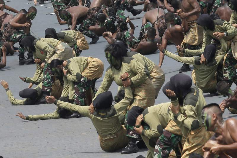 """FILE - In this Oct. 5, 2017, record  photo, pistillate  members of Indonesian Army amusement   their martial arts skills during a parade marking the 72nd day  of the Indonesian Armed Forces successful  Cilegon, Banten, Indonesia. Human rights groups welcomed Indonesia's determination  to halt  abusive """"virginity tests"""" connected  pistillate  recruits 7  years aft  the World Health Organization declared they had nary  technological  validity. (AP Photo/Tatan Syuflana, File)"""