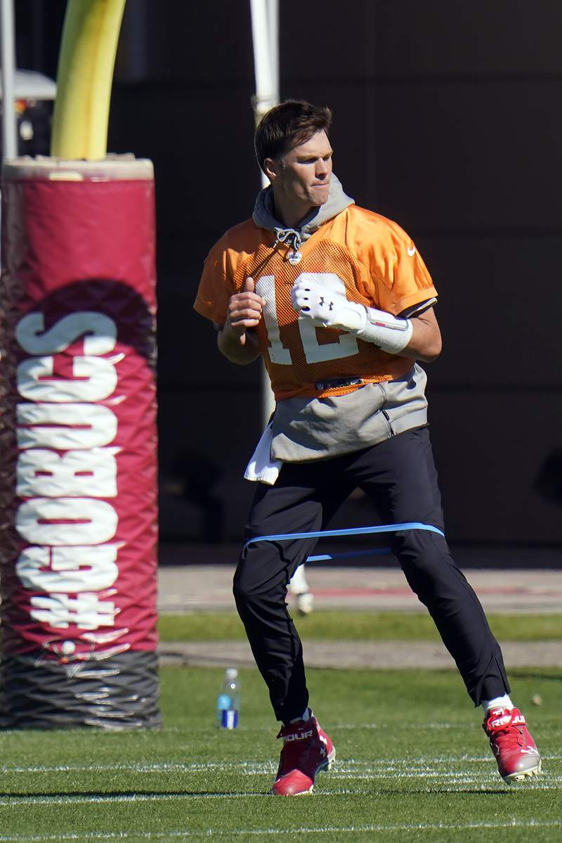 Tampa Bay Buccaneers quarterback Tom Brady (12) runs with a elastic band around his legs during an NFL football workout Thursday, Jan. 28, 2021, in Tampa, Fla. The Buccaneers play the Kansas City Chiefs in Super Bowl LV on Feb. 7. (AP Photo/Chris O'Meara)