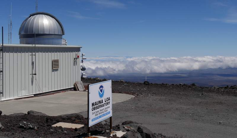 This 2019 photo provided by NOAA shows the Mauna Loa Atmospheric Baseline Observatory, high atop Hawaii's largest mountain in order to sample well-mixed background air free of local pollution. Heat-trapping carbon dioxide levels in the air peaked in May 2021, in amounts nearly 50% higher than when the industrial age began and they are growing at a record fast rate, scientists reported Monday, June 7, 2021. (Susan Cobb/NOAA Global Monitoring Laboratory via AP)
